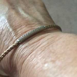 Ladies bracelet goldtone over sterling stretch